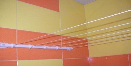 Настенная сушилка для ванной, которая не занимает лишнего пространства